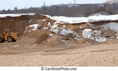 panorama on sandpit with tractor