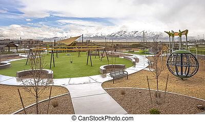 Panorama Park with view of distant snow capped mountain under blue sky and thick clouds