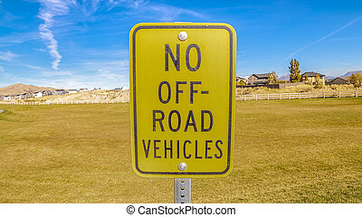 Panorama Road sign on a grassy field - No Off-road vehicles