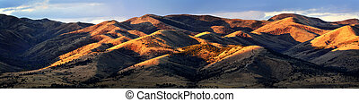 Panorama Scene of Mountains with Golden Sunlight on Them