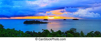 panorama scene of raining clouds and sun set sky behind koh...