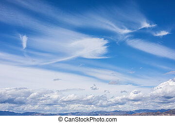 Panorama shot, Beautiful white clouds on blue sky overlooking spectacular San Gabriel mountain range, Angeles National Park, Los Angeles, California.