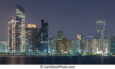 Panorama view of Abu Dhabi Skyline and seafront at night timelapse, United Arab Emirates