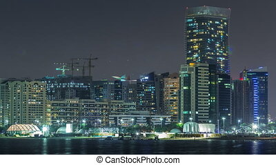 Panorama view of Abu Dhabi Skyline and seafront at night...