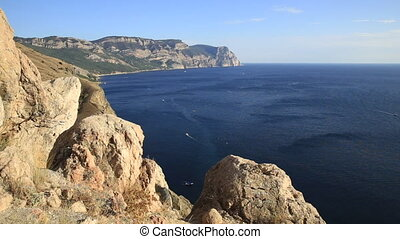 Panorama view of Black sea from ancient fortress Chembalo. Balaclava Bay with yachts in bright sunny day. Crimea