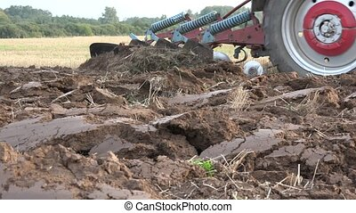 farm tractor work plough country land at autumn time. -...