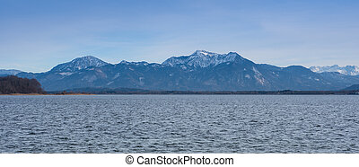 panorama view of lake chiemsee with mountains