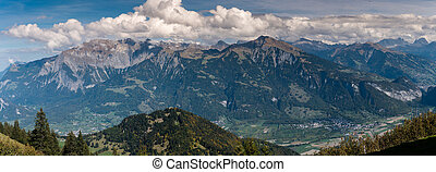 panorama view of mountain landscape in Switzerland near Maienfeld in the summertime
