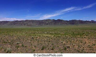 Panorama view of mountains and steppe, Gobi desert, Mongolia, 4k