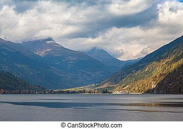 Panorama view of Poschiavo lake and Swiss Alps in Grisons, Switzerland