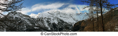 panorama view of snowy alpine mountains in italy