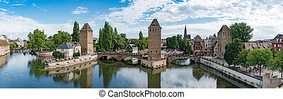 panorama view of the historic old town and canals of the city of Strassbourg as seen from the Barrage Vauban Dam