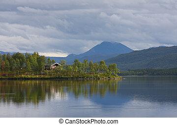 wooden houses on a lake coast