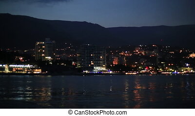 Panorama view of Yalta town from the Black sea. Night life ...