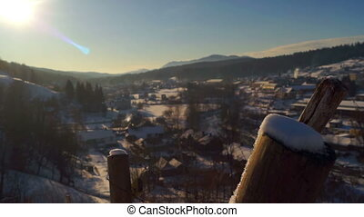 Panorama village winter sun dawn