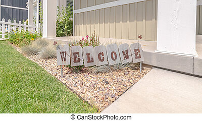 Panorama Welcome sign in front garden of traditional home