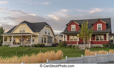 Panorama White picket fence with ornamental reeds near sunset