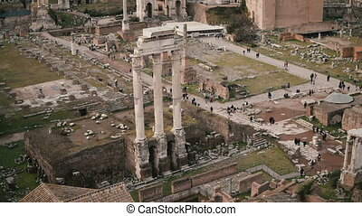 Panorama with marble Arch of Septimius Severus in Rome, Italy. The House of Vestals lies at the foot of Palatine Hill.