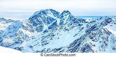 Panorama with range of mountains peaks
