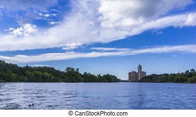 Panoramic 4K wide lens hyperlapse of river, luxury condo,...