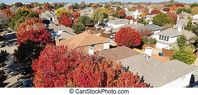Panoramic aerial close-up colorful houses during fall season in residential area near Dallas
