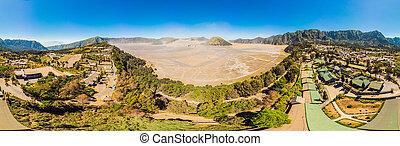 Panoramic Aerial shot of the Bromo volcano and Batok volcano...