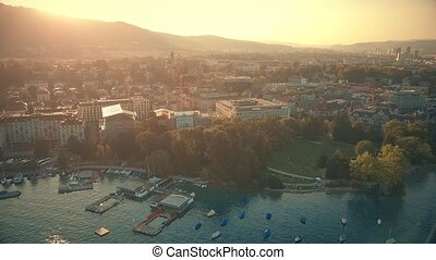 Panoramic aerial shot of Zurich cityscape in the evening