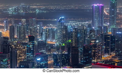 Panoramic aerial view of business bay towers in Dubai night ...