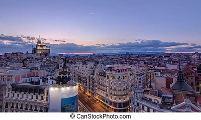 Panoramic aerial view of Gran Via day to night timelapse, Skyline Old Town Cityscape, Metropolis Building, capital of Spain, Europe.