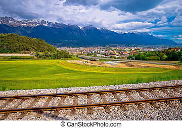 Panoramic aerial view of Innsbruck and Hafelekarspitze mountain with railroad tracks