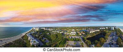 Panoramic aerial view of Naples beach at sunset, Florida