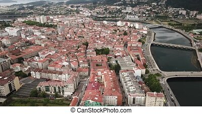 Aerial view of Pontevedra cityscape with a modern apartment buildings and sea bay, Spain