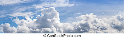 Panoramic blue sky with fluffy clouds