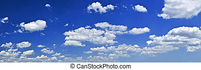 Panoramic background of blue sky with white cumulus clouds