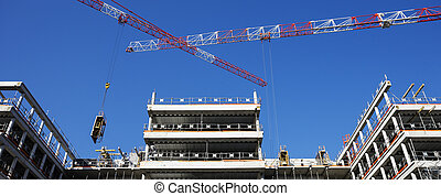 panoramic building site - building site with crane and blue...