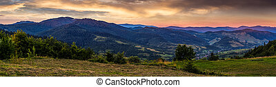 panoramic countryside landscape at sunrise. village in...