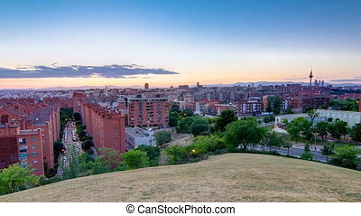 Panoramic day to night timelapse View of Madrid, Spain. Photo taken from the hills of Tio Pio Park, Vallecas-Neighborhood.