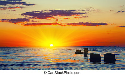sunset sky over sea at dusk