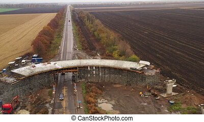 Panoramic drone shot unfinished construction of road overpass made of concrete