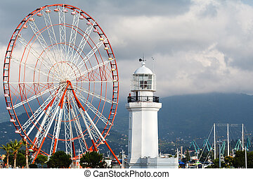 Panoramic ferris wheel in the Park of Miracles on the embankment. Batumi, Georgia
