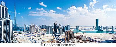 Panoramic image of Dubai city, modern cityscape, downtown...