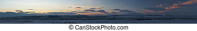Panoramic image of winter sunset in mountains, Turkey