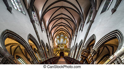 Panoramic interior view of medieval church in Ribeauville, Alsace, France