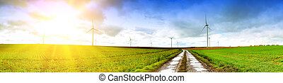 Panoramic landscape with country road and wind turbines