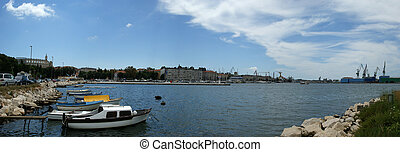Panoramic landscape with the sky, the sea and the port city ...