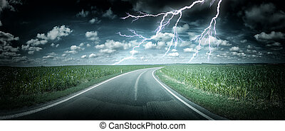 Panoramic landscape with thunderstorm over country road