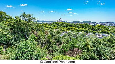 Himeji castle over the city - Panoramic long shot of Himeji...
