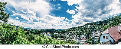 Panoramic photo of Banska Stiavnica with New castle and Old castle, Slovak republic. Travel destination. Beautiful urban landscape. Blue photo filter.