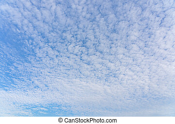 Panoramic photo of beautiful cirrocumulus white clouds on blue sky