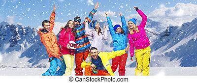 Panoramic photo of cheerful snowboarders